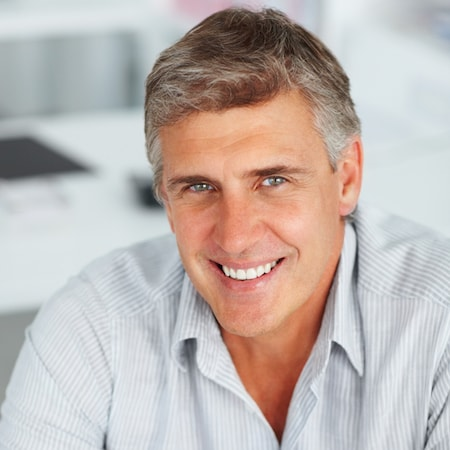 Dental Chicago - Older man who has had a dental implant
