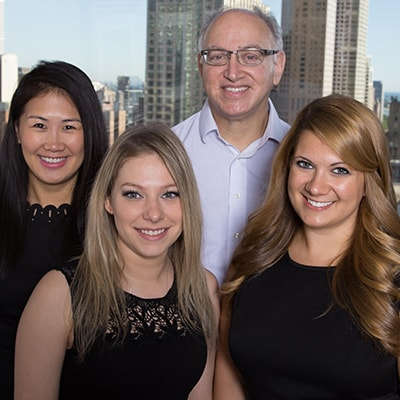 Your full Chicago restorative dentist team smiling